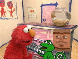 """Elmo, don't listen to it! It's EVIL!"" is what the lizard sadly did not say."